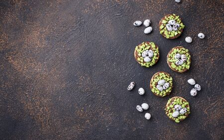 Easter cookies in shape of nest with eggs