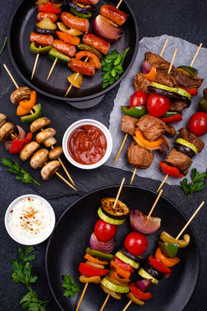 Grilled kebabs with meat, mushrooms and vegetables Stock Photo