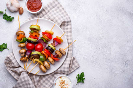 Vegetarian skewers with different grilled vegetables.
