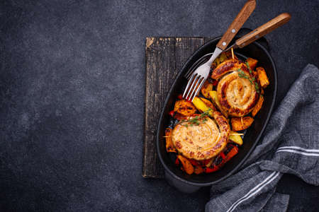 Baked chicken sausages with vegetables
