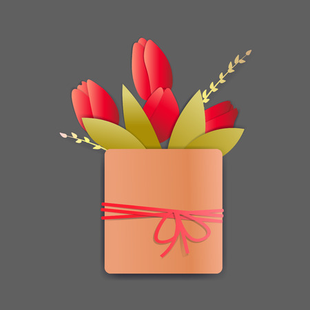 Bright red tulips in a square pot with a rope and a tiny bow. There are springs and leaves also.