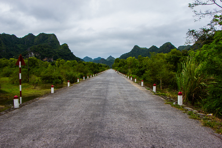 cat island: straight road, lying among the rocks. Cat Ba Island, Vietnam.