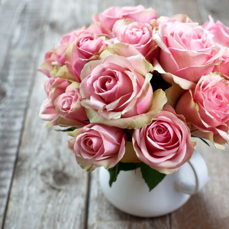 Pink roses on wooden background photo