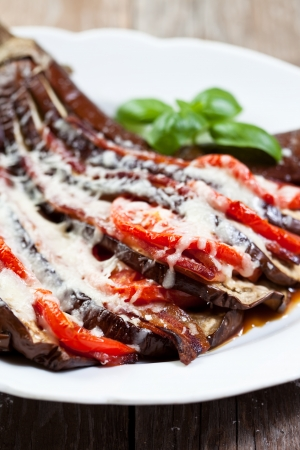 Roasted eggplant with tomatoes and cheese photo