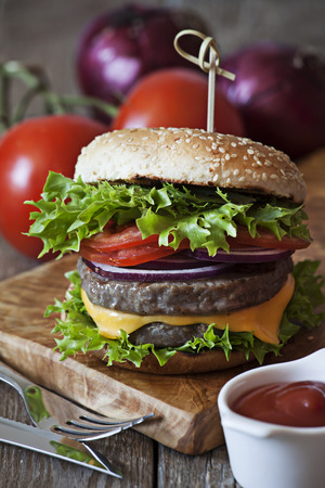 Burger on wooden board Stock Photo