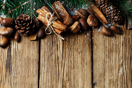 Composition with spruce, pine cones and cinnamon sticks
