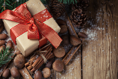Composition with a gift, pine cones and spruce Stock Photo - 69568917