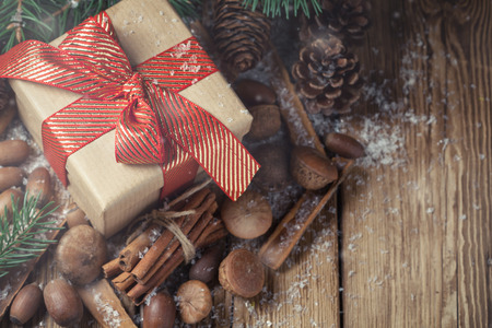 Composition with a gift, pine cones and spruce Stock Photo - 69658428