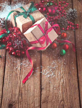 Christmas composition with gifts and decoration on wooden background Zdjęcie Seryjne