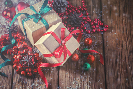 Christmas composition with gifts and decoration on wooden background Stock Photo
