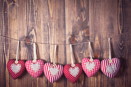 Heart shaped decoration on wooden background Stock Photo
