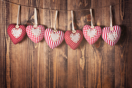 Heart shaped decoration on wooden background Zdjęcie Seryjne