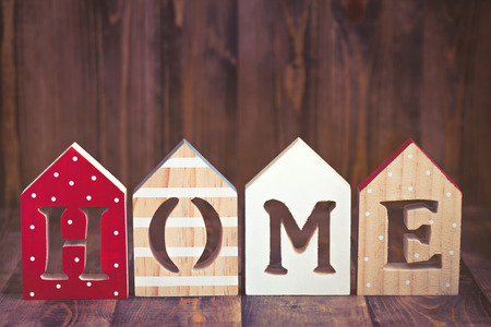 Word HOME made of painted wooden letters Stock Photo