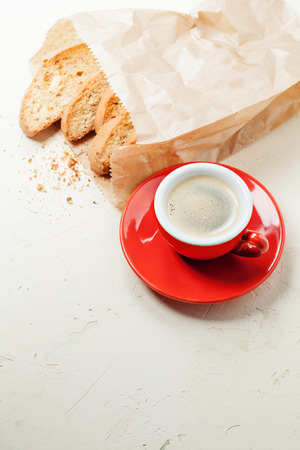 Traditional italian cookies and coffee on stone background