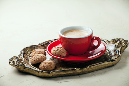 Freash coffee in a red cup with italian cookies