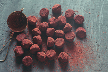 Chocolate truffles on dark stone background Zdjęcie Seryjne