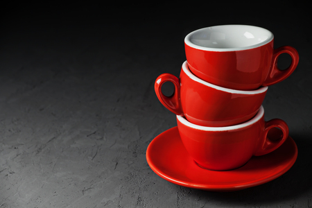 Empty red coffee cups on dark stone background Stock Photo
