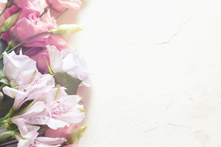 Bouquet of flowers on stone background
