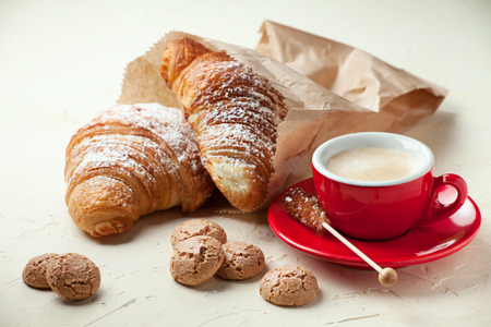 Cup of coffee and fresh pastry