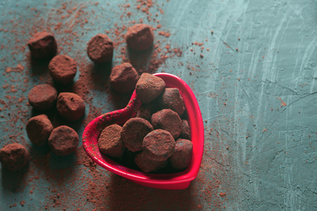 Chocolate truffles in a heart shaped bowl Stock Photo - 72096254