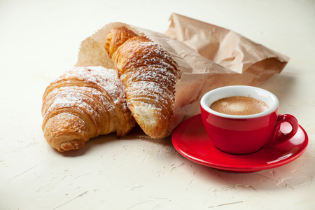 Traditional italian breakfast with coffee and croissants