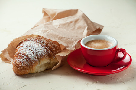 Traditional italian breakfast with coffee and croissant