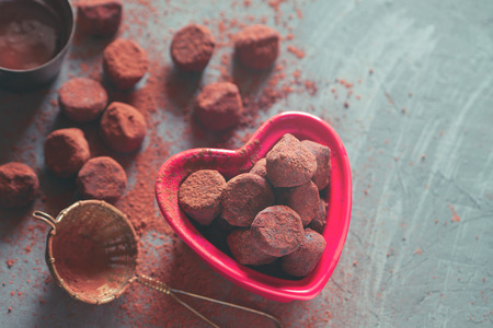 Chocolate truffles in a heart shaped bowl Stock Photo