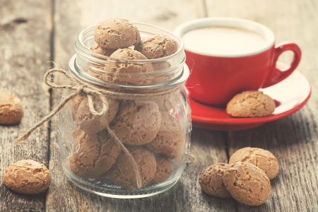Traditional italian cookies in a jar and a cup of coffee Zdjęcie Seryjne