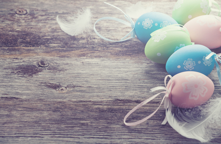 Decorative Easter eggs on wooden background