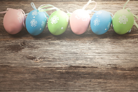 Easter eggs in a row on wooden background