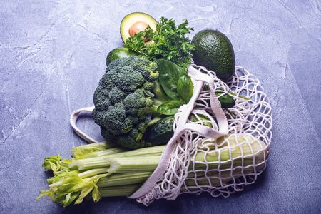 Green vegetables in a cotton bag. Green eating concept Stock fotó