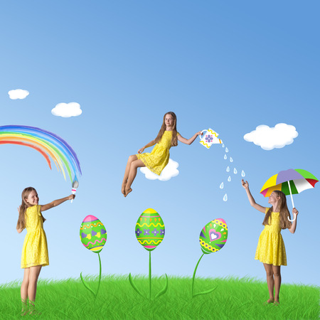 Happy Easter! Colorful picture with bright decorated eggs, grass and girls in yellow dresses photo