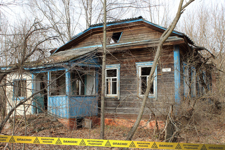 radiation hazard: Abandoned overgrown house in Chernobyl Zone. Ukraine. Signs of radiation hazard