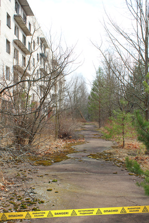 desolated: Derelict street and building in Chernobyl Zone. Ukraine Stock Photo