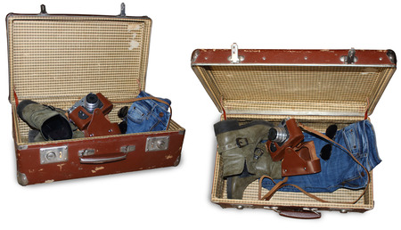 unexplored: Old suitcase with boots camera jeans and sunglass isolated on white with PS Path to extract in different views