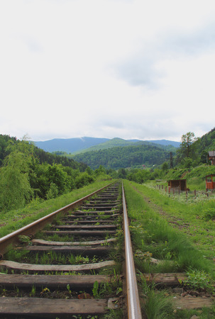 wood railroads: Old rails going far away to the Mountains Landscape