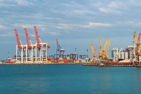 Harbor cranes and different brands cargo in Odessa Harbor