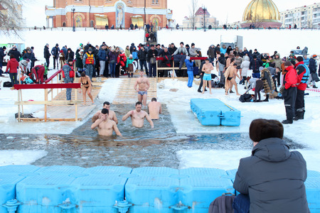 plunging: The Day of Holy Manifestation, Dnipro river, Kiev, Ukraine, January 19, 2016. Many unidentified people plunging into ice water. Old Ukrainian tradition. Air temperature -7C 19,4F. Editorial. Editorial