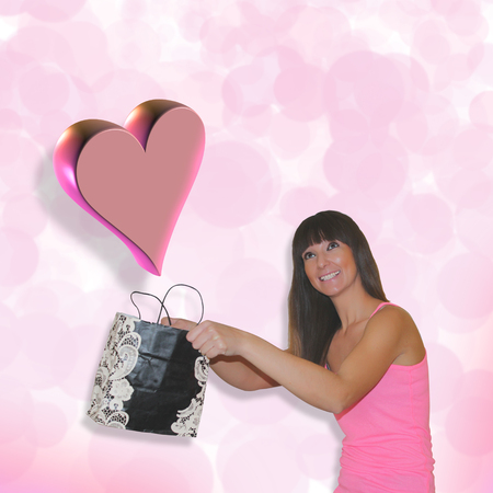 St Valentines Day. Pretty girl catching big pink falling heart in her bag