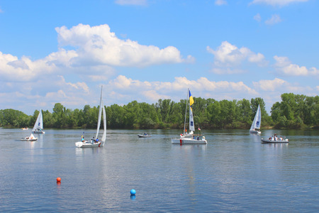 yachtsman: Hetman Cup 2016 Regatta, Dnipro river, Kiev, Ukraine, May 9, 2016. Unidentified yachts are preparing for the regatta on Dnipro gulf of Obolon. Editorial.