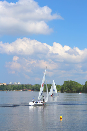 yachtsman: Hetman Cup 2016 Regatta, Dnipro river, Kiev, Ukraine, May 9, 2016. Unidentified yachtsmen are preparing for the regatta. Editorial.