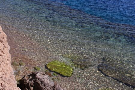 Transparent and clear waters of Red Sea. Rocky shore. Surf. Great place for vacation