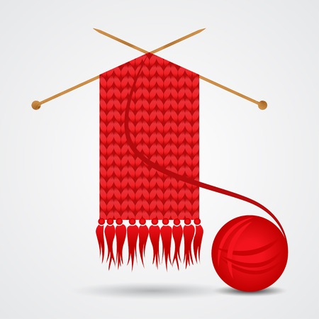 Knitted red scarf with a yarn ball
