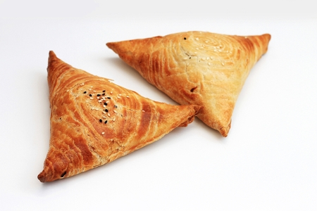 Isolated samosa on white background, Indian and eastern food.