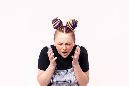 Closeup portrait angry unhappy young woman, indignant, screaming. Isolated white background. Negative human emotion, facial expression, reaction perception. Stok Fotoğraf