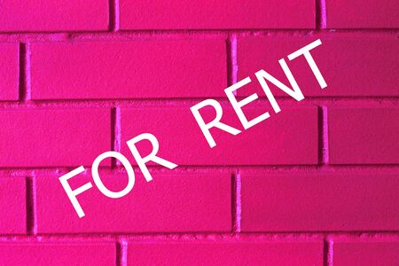 Concept rent. Inscription For Rent on a brick wall, pink color, neon. Business and Finance. Neon background. Stockfoto