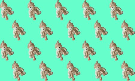 Seamless pattern, toy teddy bear on a mint-green background. Horizontal.