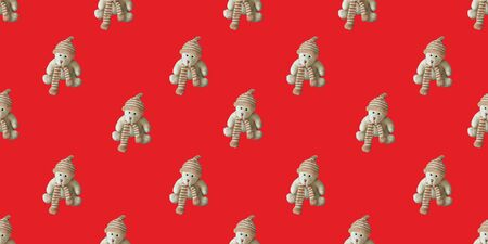 Seamless pattern, toy teddy bear on a red background. Horizontal banner. Stockfoto
