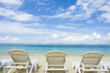blue beach with chairs  photo