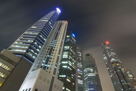 Night skyline of Singapores business district photo